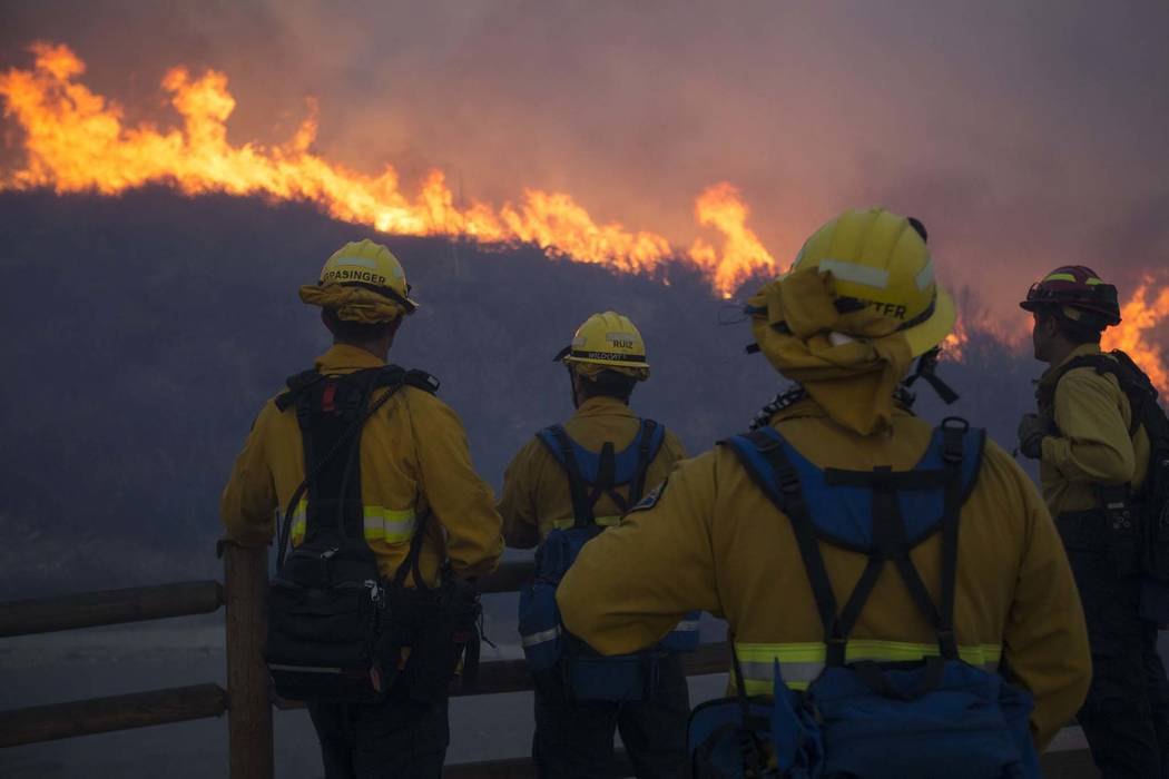 Firefighters watch a wildfire in Thousand Oaks, Calif., on Friday, Nov. 9, 2018. (Richard Brian/Las Vegas Review-Journal) @vegasphotograph