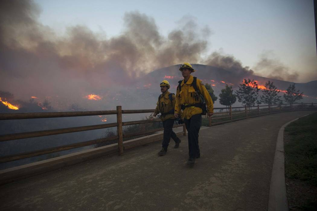 Firefighters near a wildfire in Thousand Oaks, Calif., on Friday, Nov. 9, 2018. (Richard Brian/Las Vegas Review-Journal) @vegasphotograph