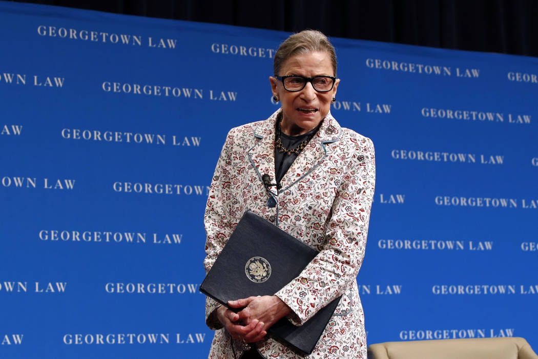 Supreme Court Justice Ruth Bader Ginsburg leaves the stage after speaking to first-year students at Georgetown Law in Washington on Sept. 26, 2018. Ginsburg has been hospitalized after fracturing ...
