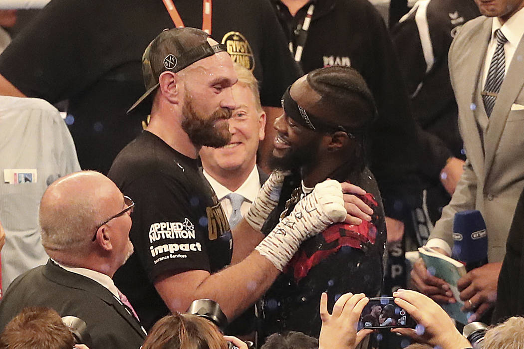 Tyson Fury, left, and WBC heavyweight champion Deontay Wilder face each other saturday, after Tyson Fury beat Francesco Pianeta during their Heavyweight fight, at Windsor Park in Belfast, Northern ...