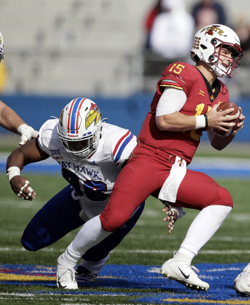 Iowa State quarterback Brock Purdy (15) is sacked by Kansas defensive lineman KeyShaun Simmons (98) during the second half of an NCAA college football game in Lawrence, Kan., Saturday, Nov. 3, 201 ...