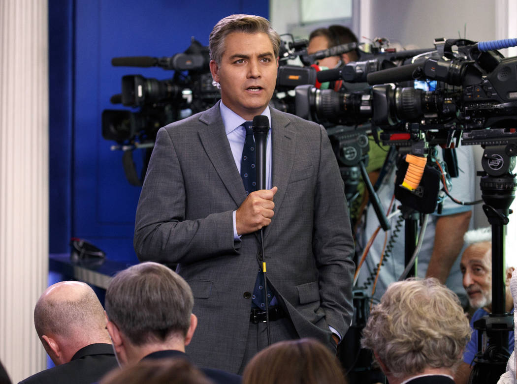FILE - In this Aug. 2, 2018 file photo, CNN correspondent Jim Acosta does a stand up before the daily press briefing at the White House in Washington. The White House on Wednesday suspended the pr ...