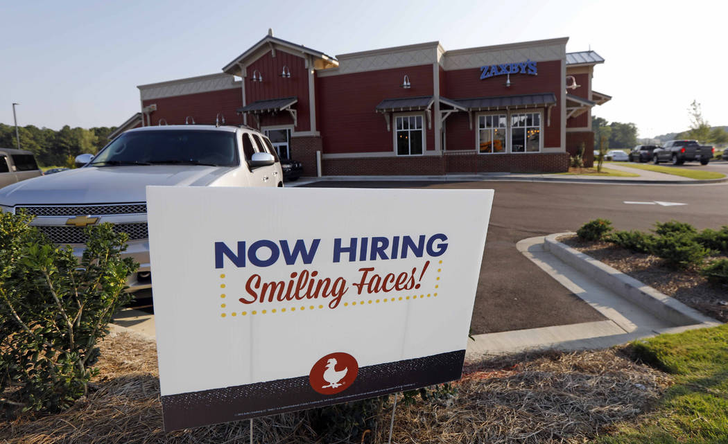 This July 25, 2018, photo shows a help wanted sign at a new Zaxby's restaurant in Madison, Miss. On Friday, Sept. 7, the Labor Department reports on job openings and labor turnover for August. (AP ...