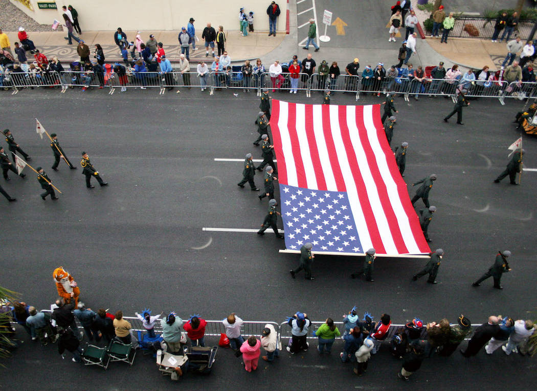 Bonanza High School Junior ROTC members carry a large American flag during the 2006 Veterans Day Parade in downtown Las Vegas (Ronda Churchill/Las Vegas Review-Journal)