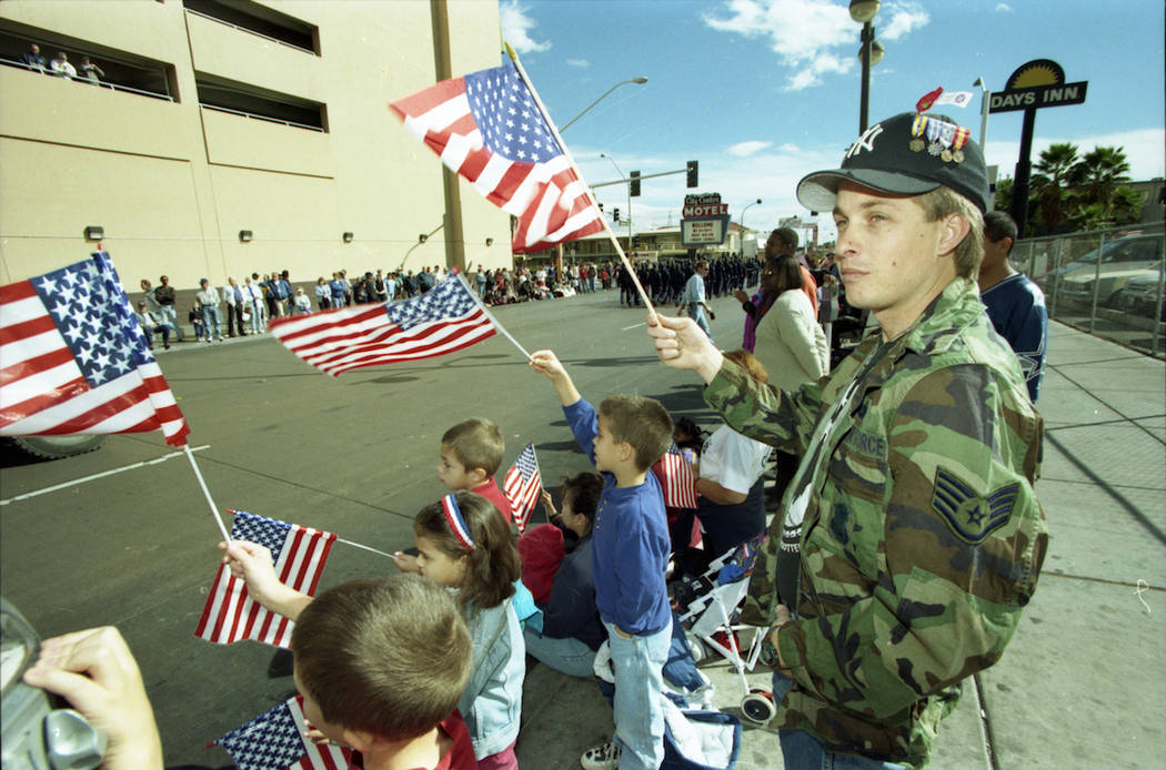 Attendees wave flags during the 1997 Veterans Day parade in downtown Las Vegas. (Las Vegas Review-Journal file)