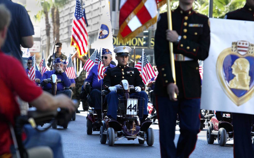 Members of the Military Order of the Purple Heart, Greater Las Vegas Chapter 711, participate in the 2014 Veterans Day parade in downtown Las Vegas. (John Gurzinski/Las Vegas Review-Journal)