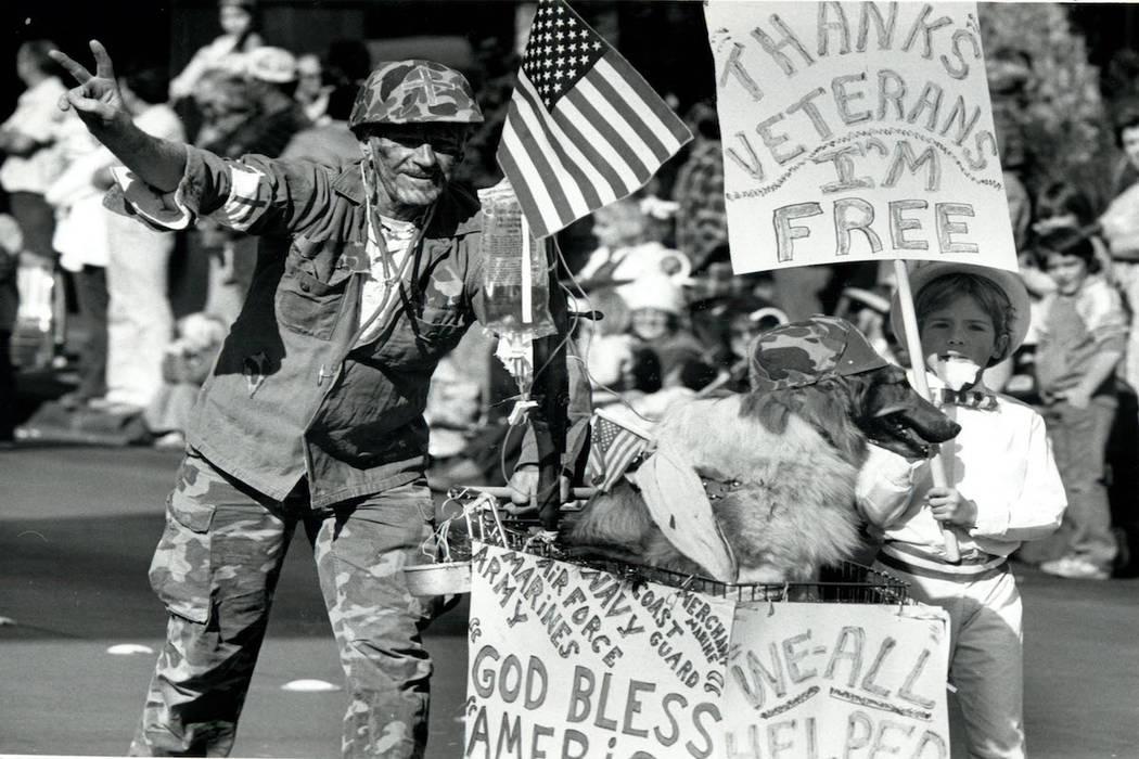 John McMillin, Marsha the Dog, Bobby McBeth, take part in the 1982 Veterans Day Parade. (Wayne Kodey/Las Vegas Review-Journal)