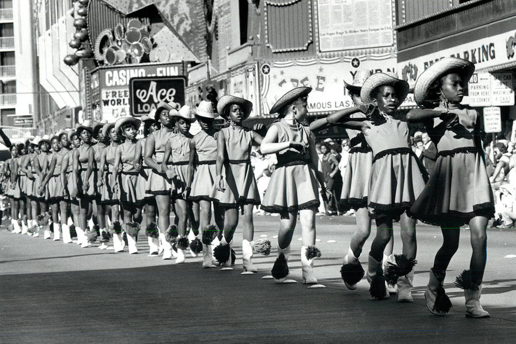 A drill team walks on Fremont St. in the 1981 Veterans Day Parade. (Gary Thompson/Las Vegas Review-Journal)