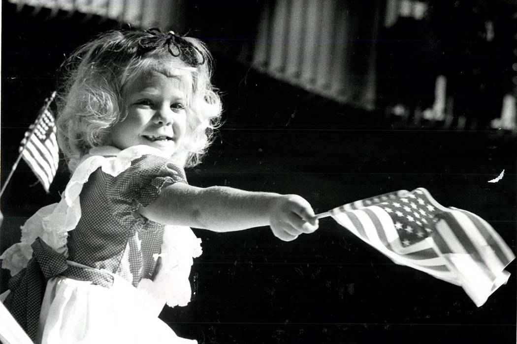 Sheila Wittern, age 6, waves her flag at the 1981 Veterans Day Parade in Las Vegas. (Gary Thompson/Las Vegas Review-Journal)