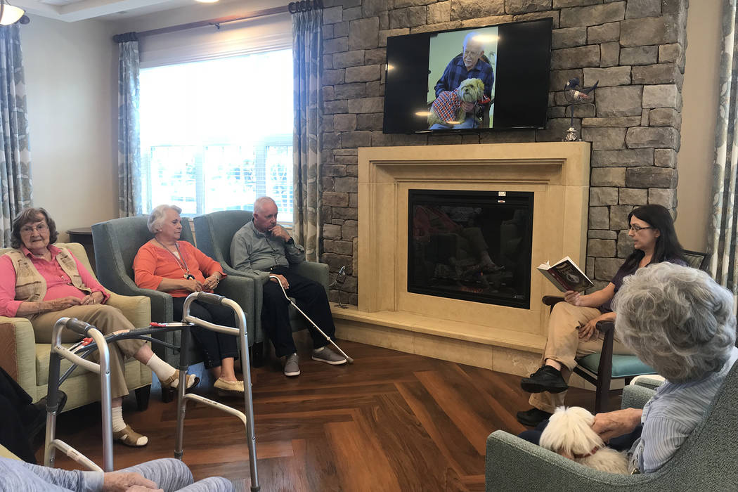 "Poet's Walk Henderson memory care patients listen to ""Treasure Island,"" read by Susan Bollinger. (Las Vegas Review-Journal)"