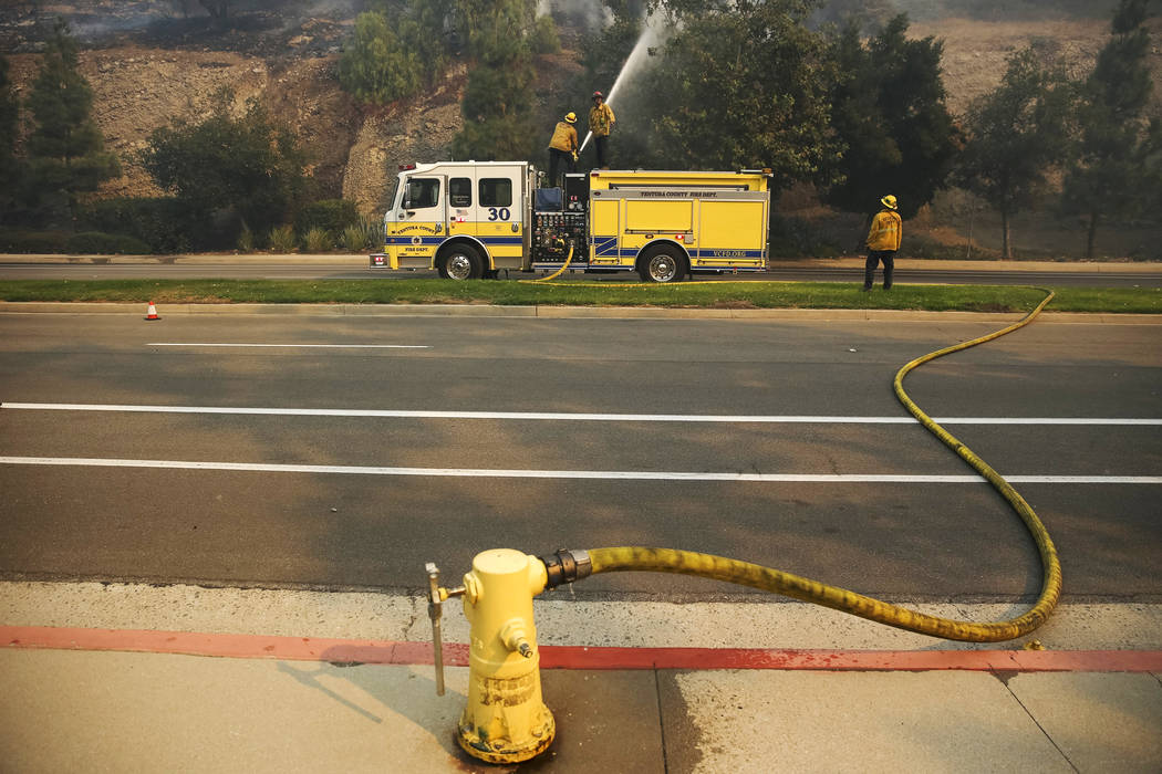 Ventura County firefighters work to contain a wildfire along Lindero Canyon Road in Westlake Village, Calif., on Friday, Nov. 9, 2018. Richard Brian Las Vegas Review-Journal @vegasphotograph