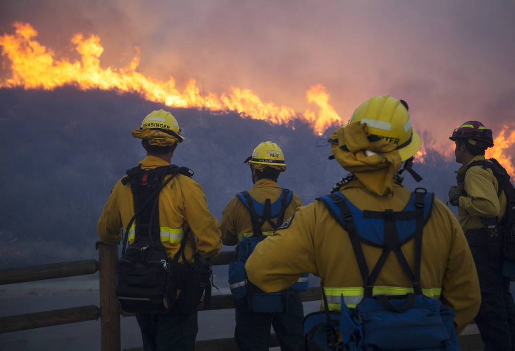Firefighters keep watch over a wildfire burning on a hillside near the Westlake Village Community Park in Westlake Village, Calif., on Friday, Nov. 9, 2018. Richard Brian Las Vegas Review-Journal ...