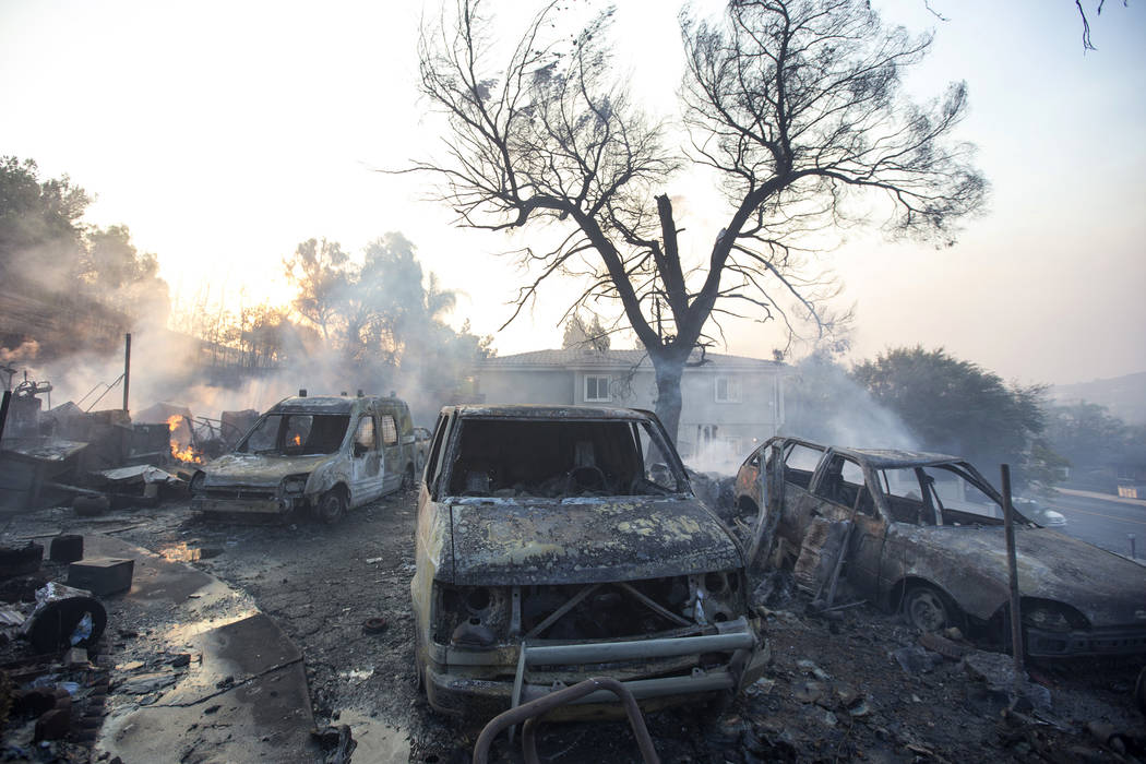 Burned cars are seen on a property ravaged by a wildfire in Thousand Oaks, Calif., on Friday, Nov. 9, 2018. Richard Brian Las Vegas Review-Journal @vegasphotograph