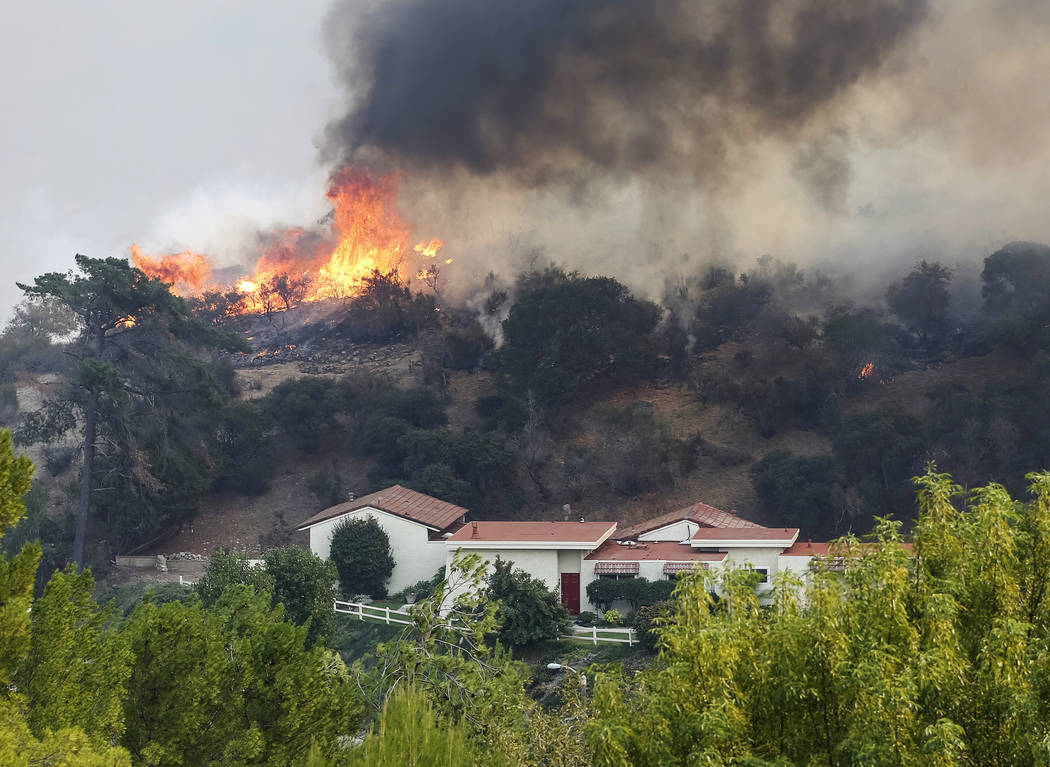A wildfire approaches a hillside home in Westlake Village, Calif., on Friday, Nov. 9, 2018. Richard Brian Las Vegas Review-Journal @vegasphotograph