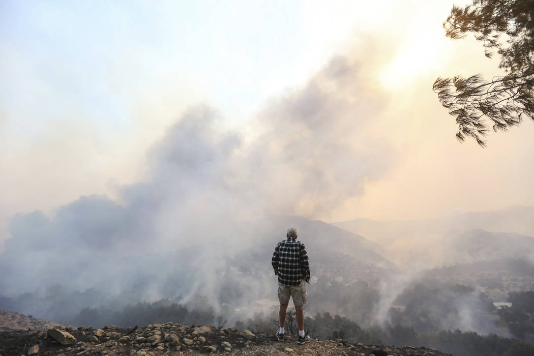 Jorge Martins keeps an on his Oak Forrest neighborhood home as a wildfire burns through his neighborhood in Westlake Village, Calif., on Friday, Nov. 9, 2018. Richard Brian Las Vegas Review-Journa ...