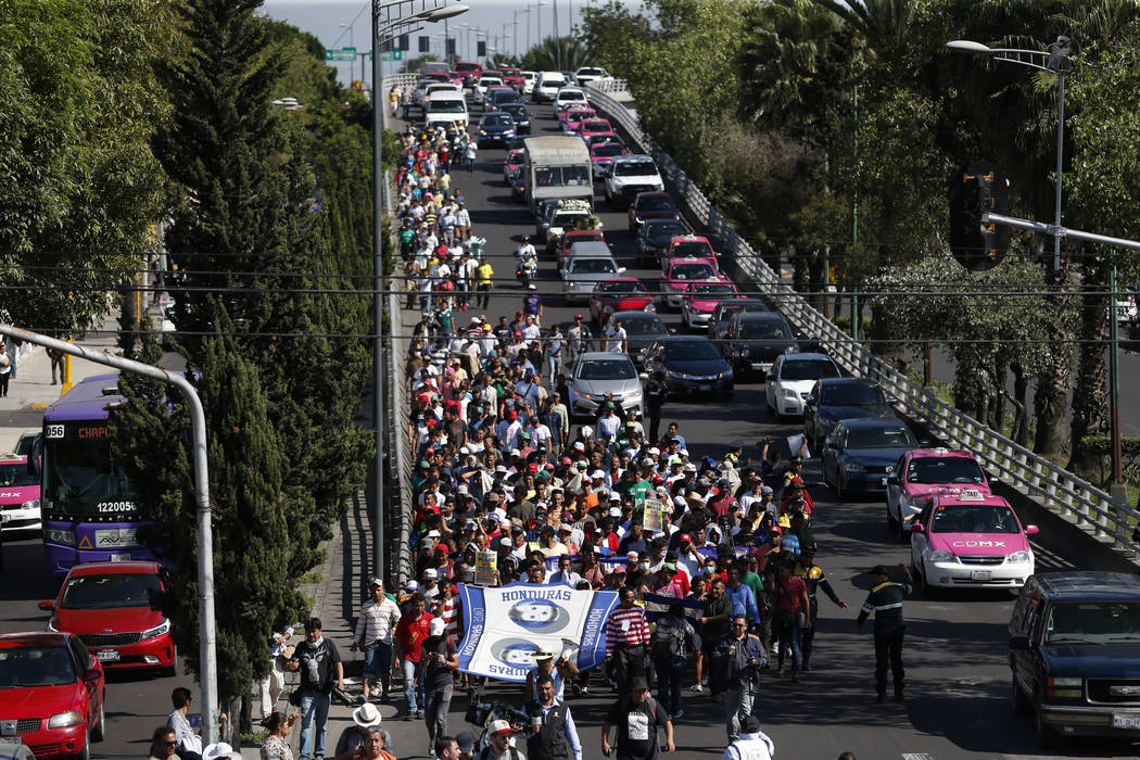 A group of Central American migrants, representing the thousands participating in a caravan trying to reach the U.S. border, undertake an hours-long march to the office of the United Nations' huma ...