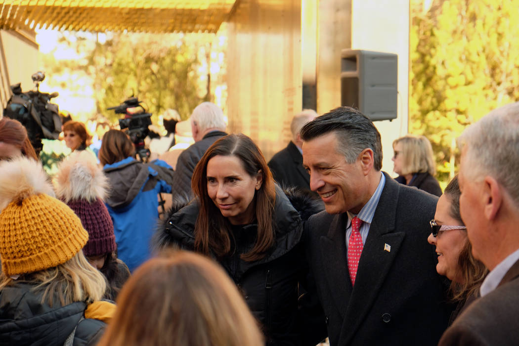 Gov. Brian and first lady Lauralyn Sandoval greet attendees at the dedication of the Battle Born Memorial in Carson City on Friday, Nov. 9, 2018. (Bill Dentzer/Las Vegas Review-Journal)