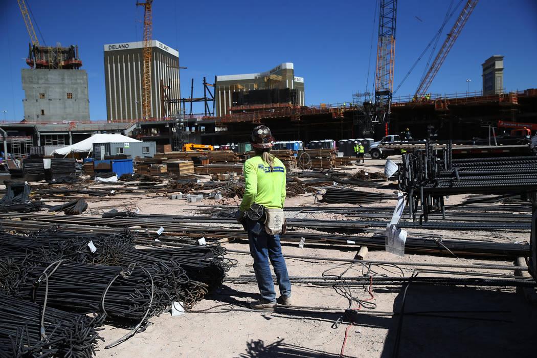 A worker stands inside the bowl of the Raiders stadium construction site in Las Vegas, Thursday, Sept. 27, 2018. Erik Verduzco Las Vegas Review-Journal @Erik_Verduzco