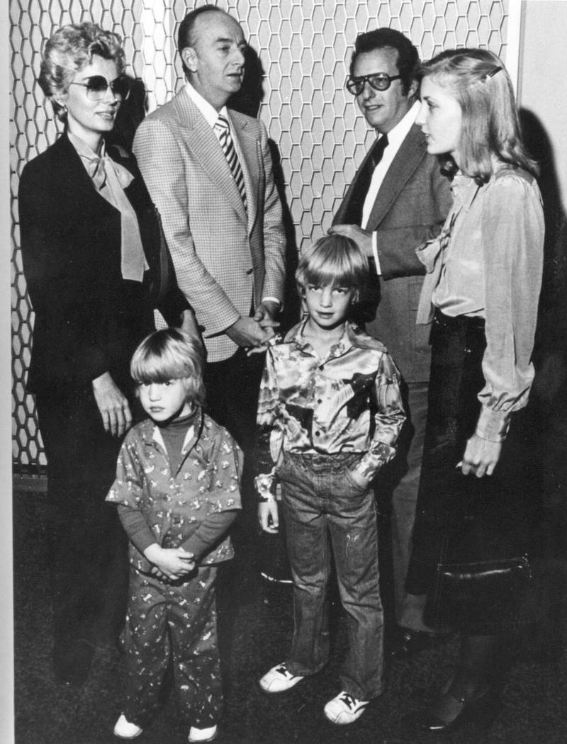 """Las Vegas casino operator Frank """"Lefty"""" Rosenthal, second from left, stands with his attorney Oscar Goodman, second from right, and his wife, Geri, left, and children, Stephanie, Steven and Robin ..."""