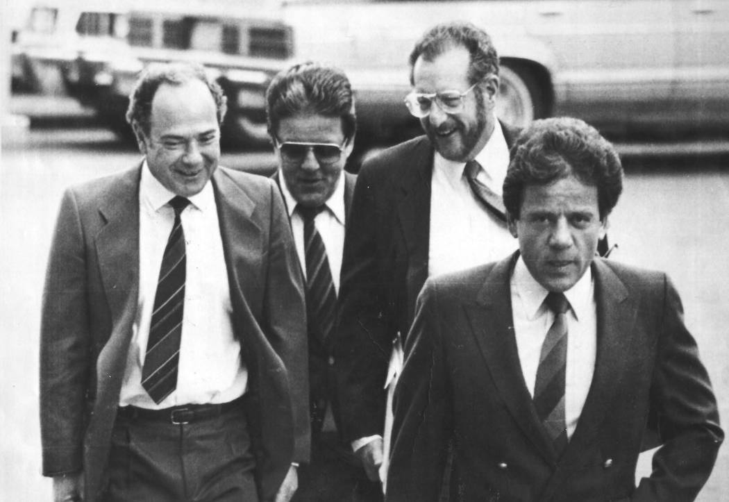 """Reputed Las Vegas crime figure Anthony """"The Ant"""" Spilotro, second from left, and his brother Michael, right, enter a Las Vegas courtoom in February 1986 along with attorneys Jerry Werksman, left, ..."""