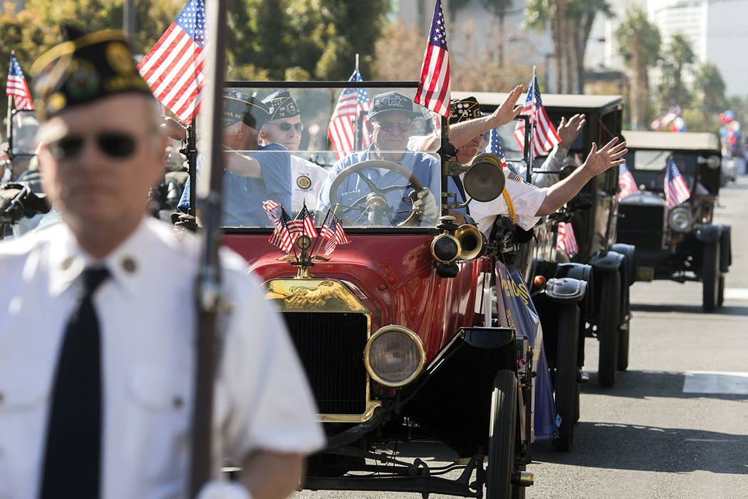 Members of American Legion Post 76 wave to the crowd on 4th Street during the Veterans Day Parade in downtown Las Vegas on Friday, Nov., 11, 2016. (Las Vegas Review-Journal)