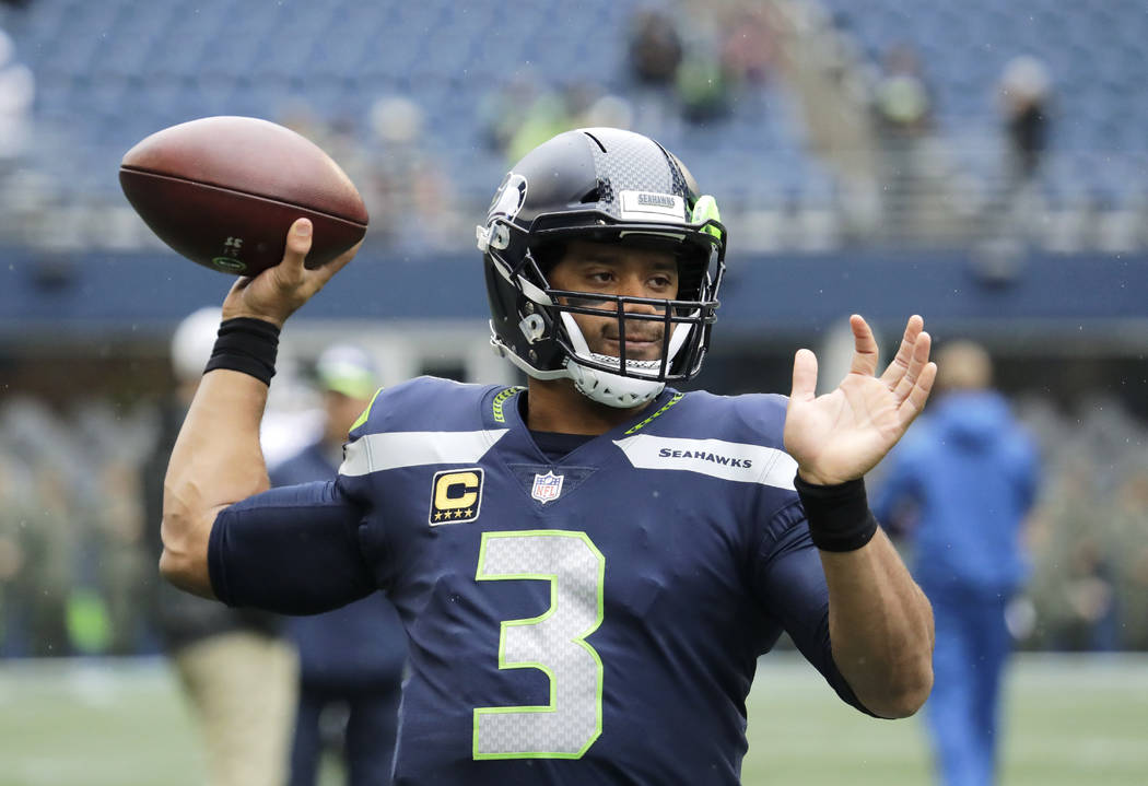 Seattle Seahawks quarterback Russell Wilson throws during warmups before an NFL football game against the Los Angeles Rams, Sunday, Oct. 7, 2018, in Seattle. (AP Photo/Elaine Thompson)