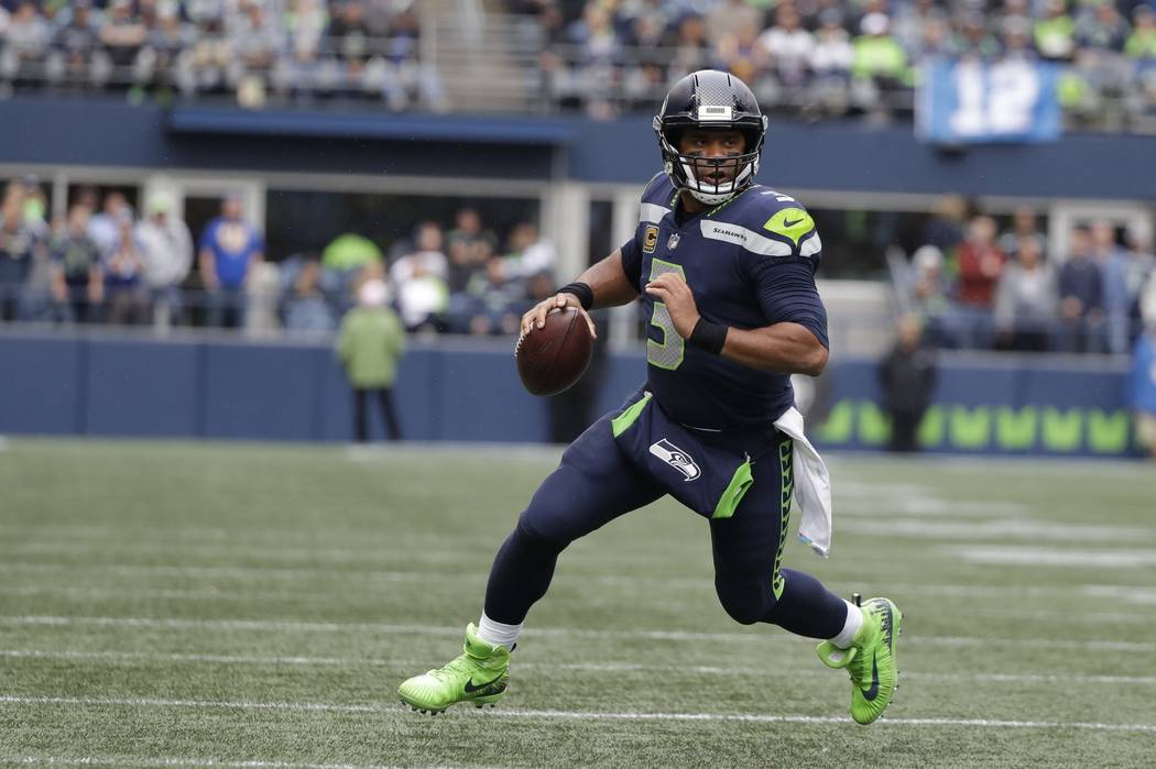 Seattle Seahawks quarterback Russell Wilson scrambles against the Los Angeles Rams during the second half of an NFL football game, Sunday, Oct. 7, 2018, in Seattle. (AP Photo/Elaine Thompson)