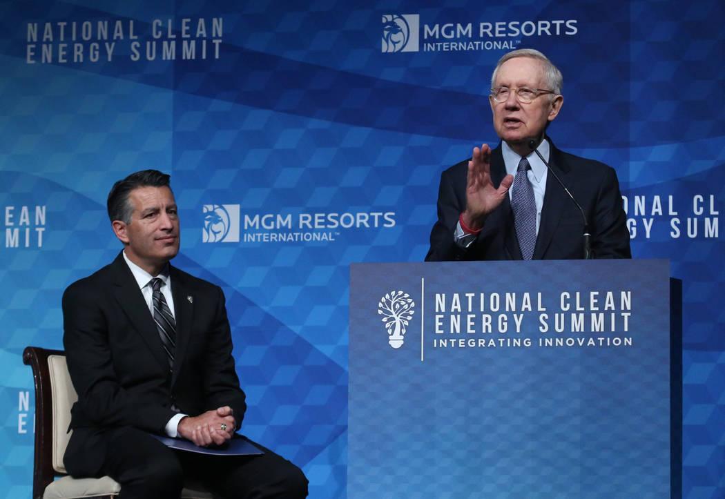 Former U.S. Sen. Harry Reid, D-Nev., speaks as Gov. Brian Sandoval looks on during the National Clean Energy Summit Friday, Oct. 13, 2017, in Las Vegas. Bizuayehu Tesfaye Las Vegas Review-Journal ...