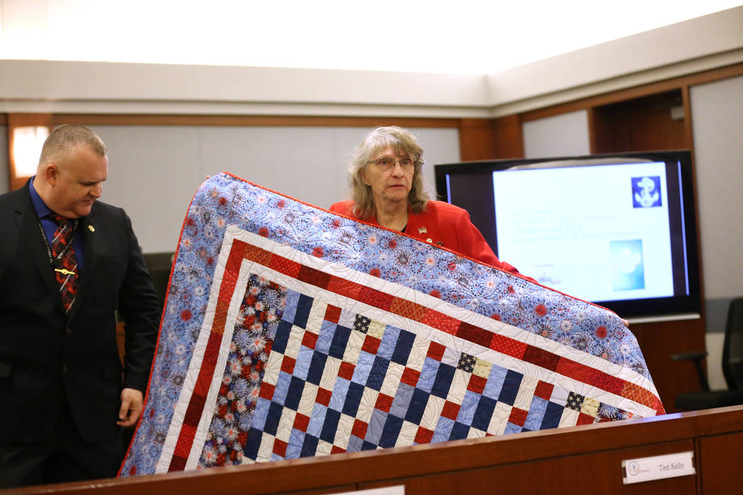 Quilts of Valor's Jarenie Trachier presents a quilt for a graduate during the Veterans Treatment Court Promotion and Graduation Day at the Regional Justice Center in Las Vegas, Friday, Nov. 9, 201 ...