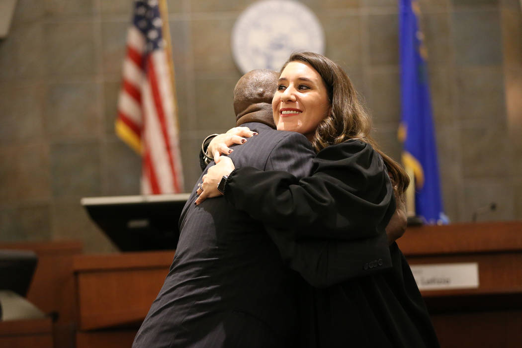 Navy Veteran Edward Smith, left, hugs Judge Harmony Leticia after graduating during the Veterans Treatment Court Promotion and Graduation Day at the Regional Justice Center in Las Vegas, Friday, N ...