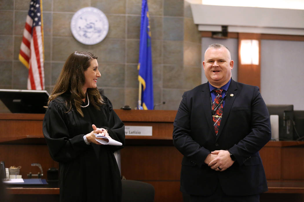 Judge Harmony Letizia, left, with guest speaker Las Vegas Metropolitan Police Department Deputy Chief Richard Forbus, during the Veterans Treatment Court Promotion and Graduation Day at the Region ...