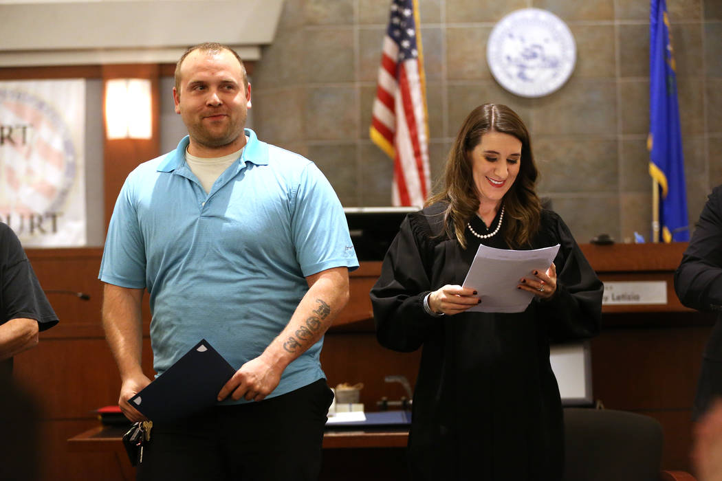 Marine Corps veteran Troy Eplin, left, with Judge Harmony Leticia, is recognized for his promotion during the Veterans Treatment Court Promotion and Graduation Day at the Regional Justice Center i ...