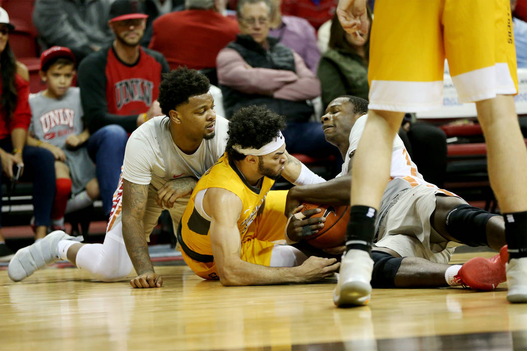 UNLV Rebels forward Tervell Beck (14) and forward Cheickna Dembele (15) fight for the ball against Valparaiso Crusaders guard Markus Golder (5) during the first half of the basketball game at the ...