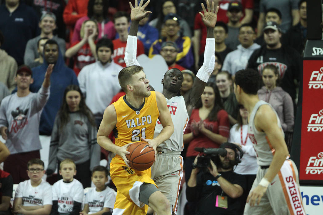 Valparaiso Crusaders center Derrik Smits (21) turns for an offensive foul against UNLV Rebels forward Cheikh Mbacke Diong (34) during the first half of the basketball game at the Thomas & Mac ...
