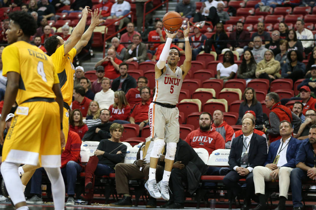 UNLV Rebels guard Noah Robotham (5) takes a shot fore a score against Valparaiso Crusaders during the second half of the basketball game at the Thomas & Mack Center in Las Vegas, Wednesday, No ...