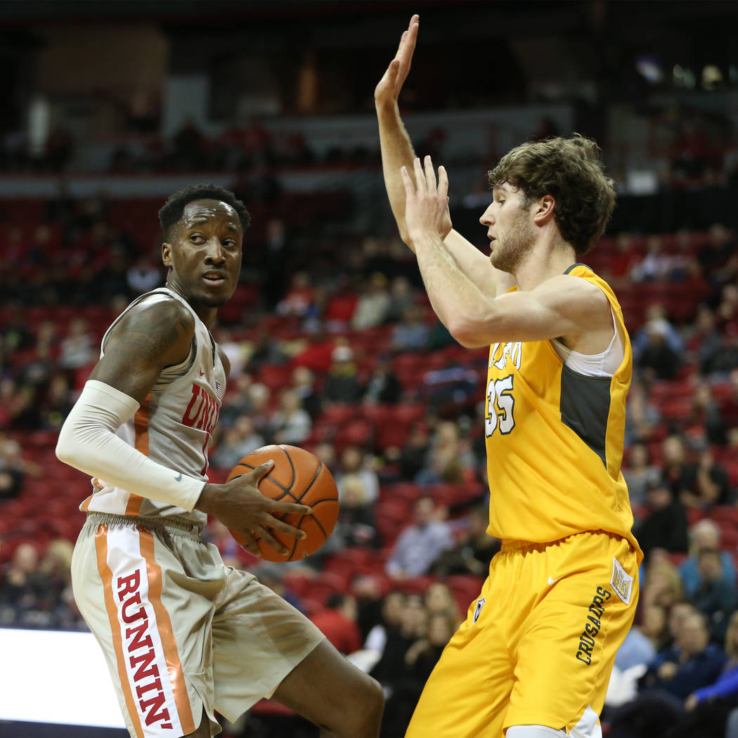 UNLV Rebels guard Kris Clyburn (1) looks for an open pass under pressure from Valparaiso Crusaders guard Ryan Fazekas (35) during the second half of the basketball game at the Thomas & Mack Ce ...