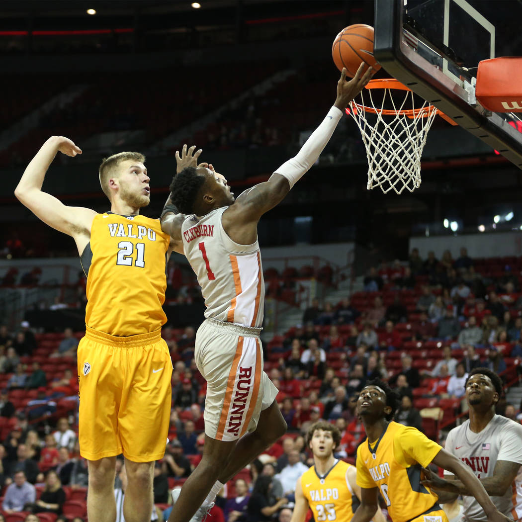 UNLV Rebels guard Kris Clyburn (1) goes up for a shot under pressure from Valparaiso Crusaders guard Ryan Fazekas (35) during the second half of the basketball game at the Thomas & Mack Center ...