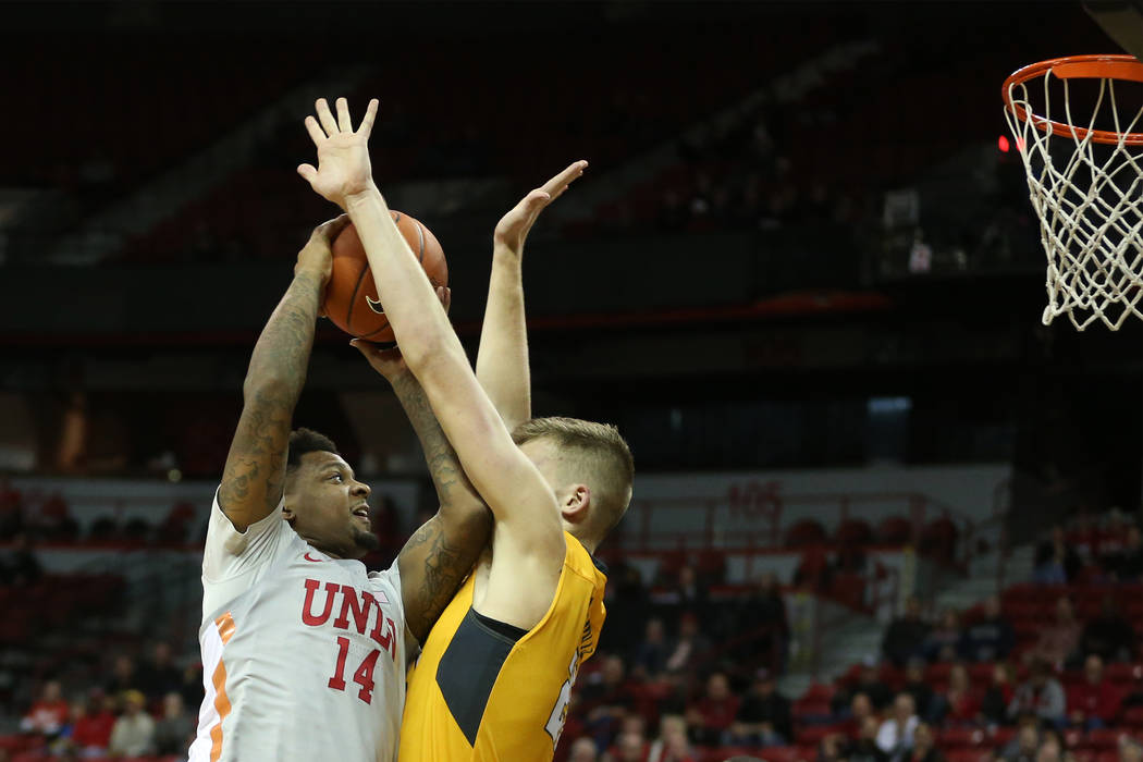 UNLV Rebels forward Tervell Beck (14) takes a shot against Valparaiso Crusaders center Derrik Smits (21) during the second half of the basketball game at the Thomas & Mack Center in Las Vegas, ...