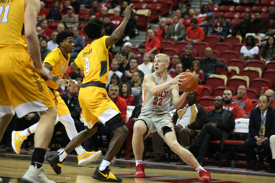 UNLV Rebels guard Trey Woodbury (22) looks for an open pass against Valparaiso Crusaders during the second half of the basketball game at the Thomas & Mack Center in Las Vegas, Wednesday, Nov. ...
