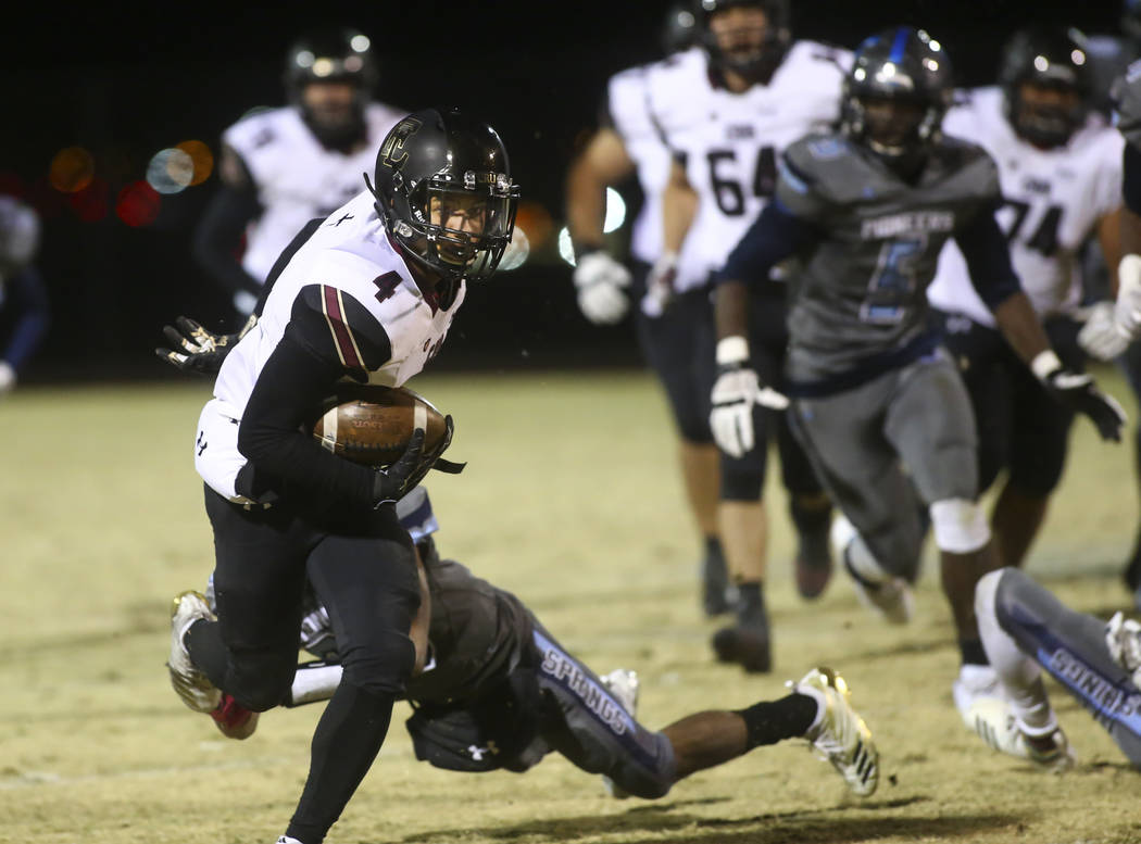 Faith Lutheran's Sebastian Burke (4) runs the ball to score a touchdown against Canyon Springs during a Mountain Region football semifinal game at Canyon Springs High School in North Las Vegas on ...