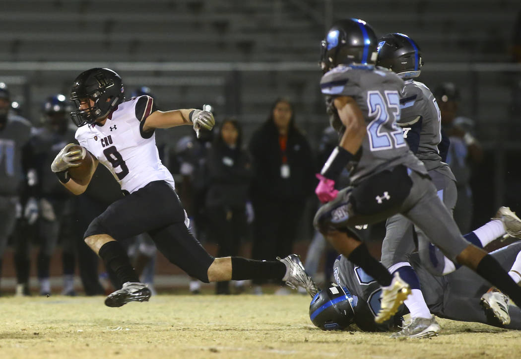 Faith Lutheran's Keagan Touchstone (9) runs the ball past Canyon Springs defenders during a Mountain Region football semifinal game at Canyon Springs High School in North Las Vegas on Friday, Nov. ...