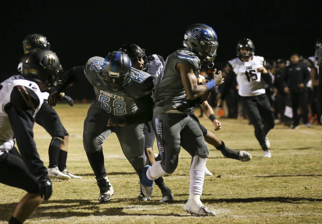 Canyon Springs' Xavier DeLong (13) scores a touchdown against Faith Lutheran during a Mountain Region football semifinal game at Canyon Springs High School in North Las Vegas on Friday, Nov. 9, 2 ...