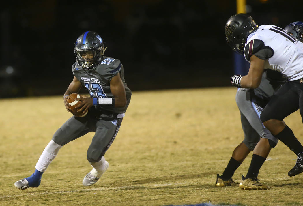 Canyon Springs' Xavier DeLong (13) runs the ball against Faith Lutheran during a Mountain Region football semifinal game at Canyon Springs High School in North Las Vegas on Friday, Nov. 9, 2018. C ...