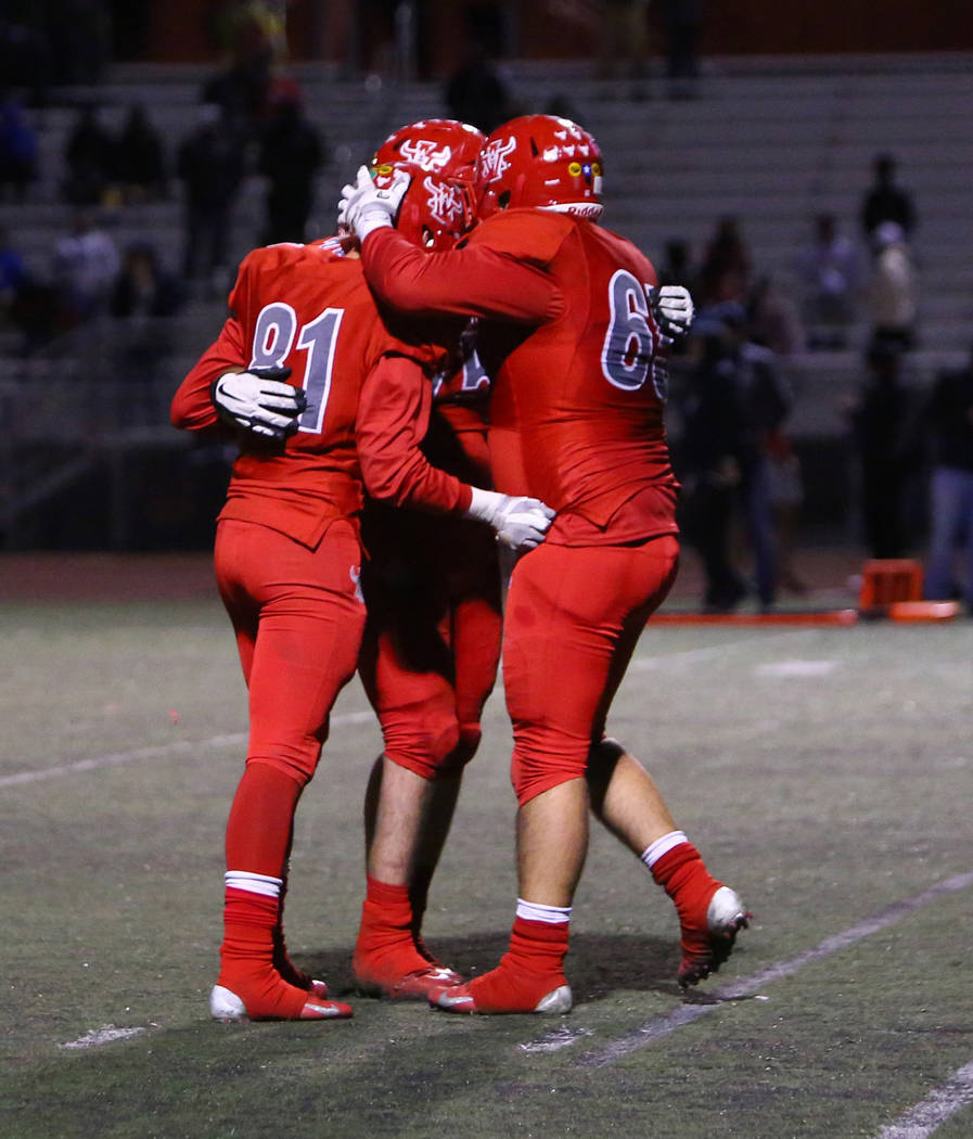 Arbor View's York St. Hillaire (81), Arbor View's Matt Smith (75) and Arbor View's Seth Johnson (65) celebrate after scoring a touchdown against Desert Pines during second half of the Mountain Reg ...