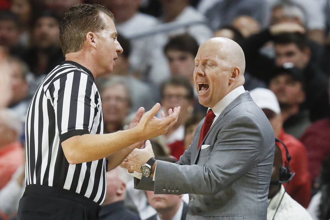 Cincinnati's head coach Mick Cronin, right, argues a call with a referee during the first half of an NCAA college basketball game against Ohio State, Wednesday, Nov. 7, 2018, in Cincinnati. (AP Ph ...
