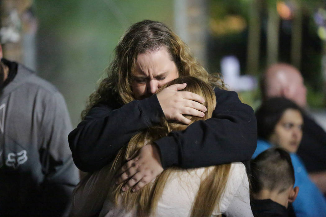 Route 91 survivor Stacie Armentrout embraces her 13-year-old daughter Denise during a vigil at the Las Vegas Healing Garden on Friday, November 9, 2018, to honor the 12 people killed in the Border ...