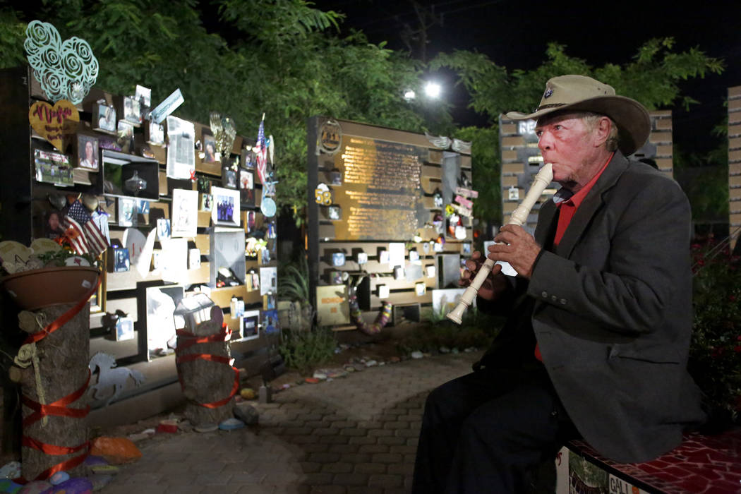 Tod Mainzer of Henderson plays recorder at the Las Vegas Healing Garden on Friday, November 9, 2018, during a vigil to honor the 12 people killed in the Borderline Bar and Grill shooting in Thousa ...