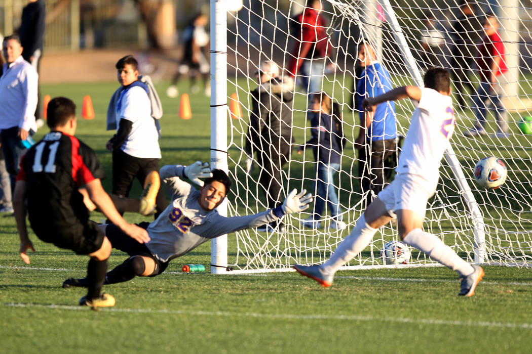 Las Vegas' Rigo Carrasco (11) scores against Durango's Jason Sotelo (92) in the first half of their Class 4A state boys soccer semifinal game at Bettye Wilson Soccer Complex in Las Vegas Friday, N ...