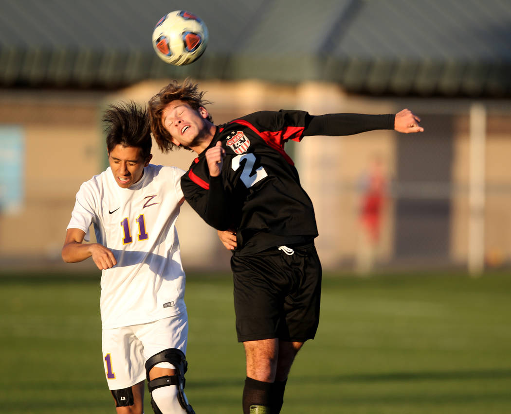 Durango's Christopher Bramasco (11) and Las Vegas' Drew Bowden (2) battle for the ball in the first half of their Class 4A state boys soccer semifinal game at Bettye Wilson Soccer Complex in Las V ...
