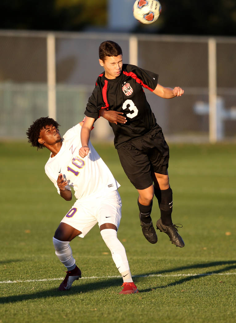 Durango's Tyson Tesfamariam (10) and Las Vegas' Carlos Sanchez (3) battle for the ball in the first half of their Class 4A state boys soccer semifinal game at Bettye Wilson Soccer Complex in Las V ...